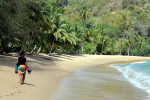 A beach goer takes a quite stroll along Englishman's Bay, Tobago